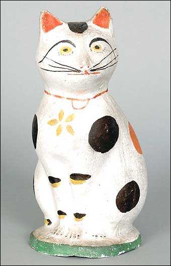 Signs of Spring at Pook and Pook - Nineteenth century chalkware cat which sold for $20,415