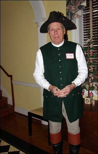 East Berlin Christmas House Tour - Bill Powell dressed up as a colonial man greeting visitors at the front door.<br>