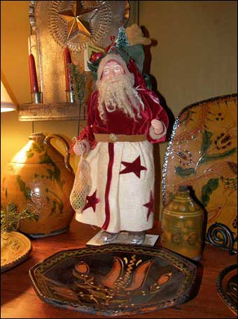 East Berlin Christmas House Tour - A decorated Christmas setting with a Santa, Schooner Redware, and a tin candleabra<br>