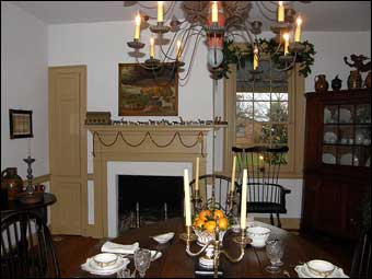 East Berlin Christmas House Tour - A dinner setting in the dining room. Notice the Noah's Ark on the mantle. A reproduction Edward Hicks hangs above the mantle.<br>