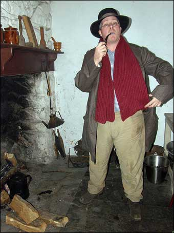 Hopewell Furnace, PA - A gentleman from 1865 smoking his pipe and enjoying the fire inside the Boarding House<br>