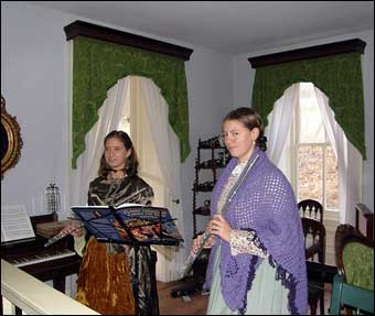 Hopewell Furnace, PA - Inside the Big House or Ironmaster's Mansion which was decorated for Christmas in the 1875 tradition. Flutists Alannah Sellman and Rachael Smith played Christmas music<br>