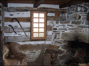 Swedish Cabin - The corner fireplace in the East Room of the Swedish Log Cabin.