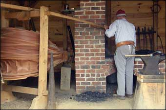 Washingtonburg, PA - The blacksmith working the shop before the 3:00pm demonstration