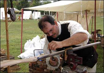 Washingtonburg, PA - Gunsmith filing the barrel of a rifle