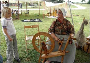 Washingtonburg, PA - Claire Moore teaching spinning to an enthusiastic young girl
