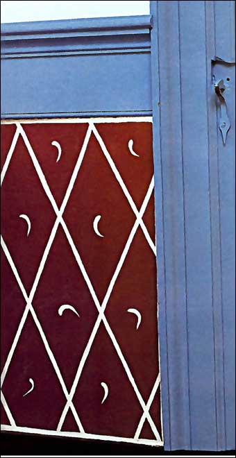 Wentz Farmstead Candlelight Tour - Crescent moon shaped designs on the dado of the wall
