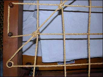 Bed Roping - Completing the tying of rope using double half hitch knots at cross pieces. <br>