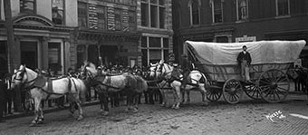 Conestoga Wagon - An old photo of a man with his Conestoga wagon and team