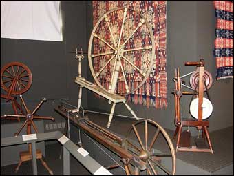 Coverlets - An assortment of spinning wheels